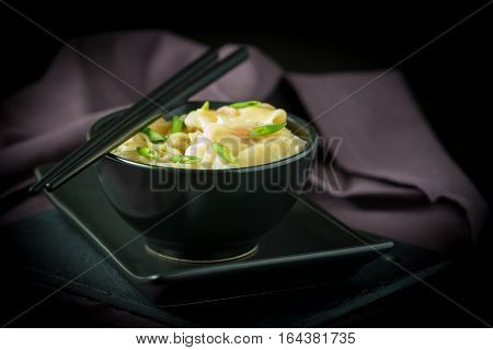 Bowl of chinese shrimp wontons and noodles.