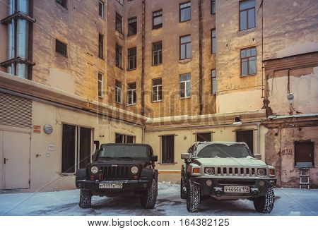 Saint Petersburg , Russia - January 08, 2017, Hammer H3 and Jeep Wrangler Jk in the courts of St. Petersburg, the Hummer H3 is a compact SUV produced by GM