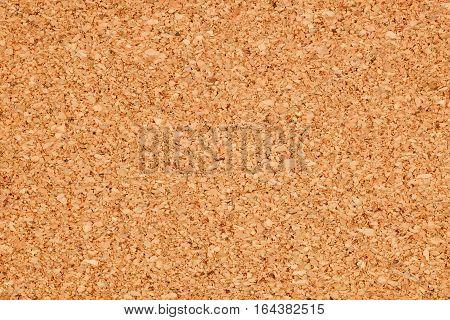Brown cork board texture background. Macro shot