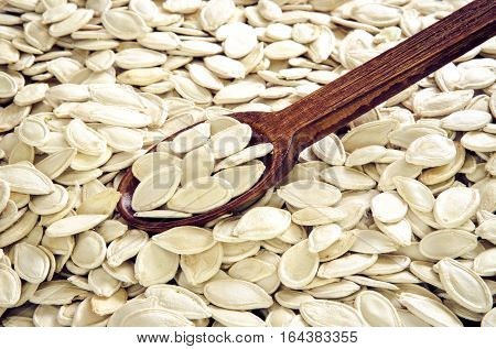 Healthy food. Pumpkin seeds with wooden spoon.