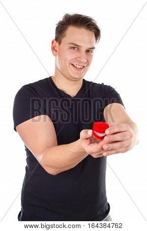 Picture of a sexy young man holding an engagement ring - isolated background