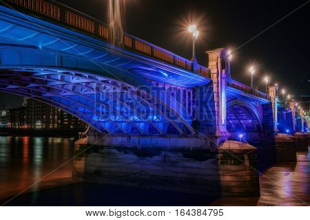 Southwark Bridge over the River Thames in central London at night