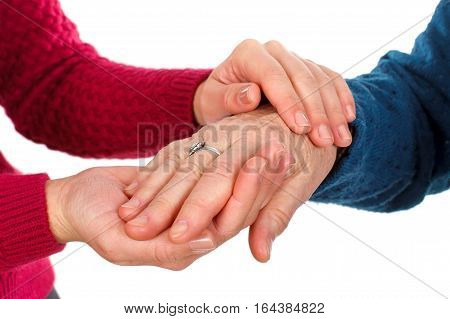 Close up picture of two women's hands - grandmother with granddaughter