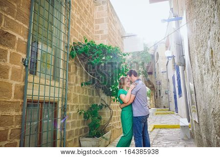 Beautiful Happy Couple Embracing And Walking On The Streets Of The Ancient City