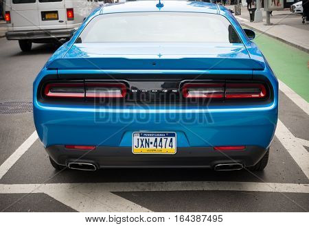 NEW YORK - APRIL 29 2016: Blue Dodge challenger in the streets of New York. It is the name of four different generations of American automobiles produced by Dodge in Detroit Michigan