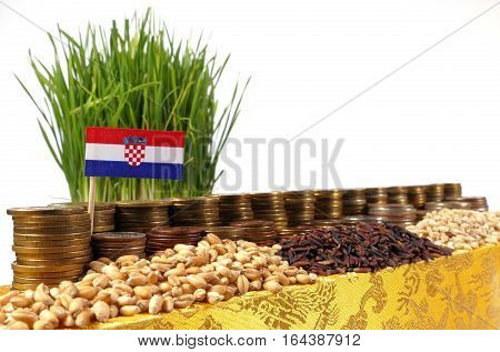 Croatia Flag Waving With Stack Of Money Coins And Piles Of Wheat And Rice Seeds