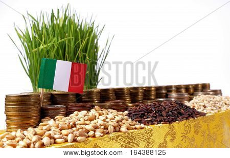 Italy Flag Waving With Stack Of Money Coins And Piles Of Wheat And Rice Seeds
