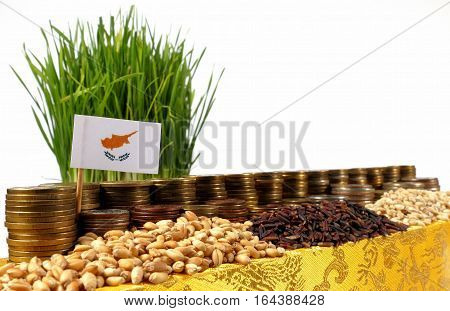 Cyprus Flag Waving With Stack Of Money Coins And Piles Of Wheat And Rice Seeds
