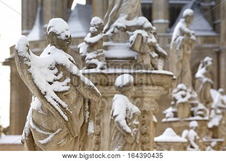 Historical statue of Angel under the snow Kutna Hora Czech republic