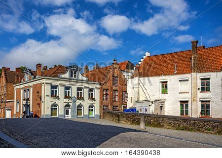BRUGES, BELGIUM - CIRCA JUNE 2014: Typical street in Bruges in June 2014. This is famous city and of one of the most popular touristic destination in Belgium