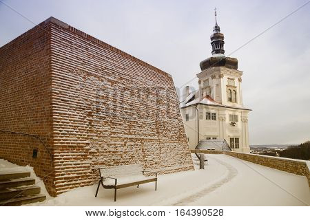 Tower of former Jesuit College in town Kutna Hora Czech republic snow fortification