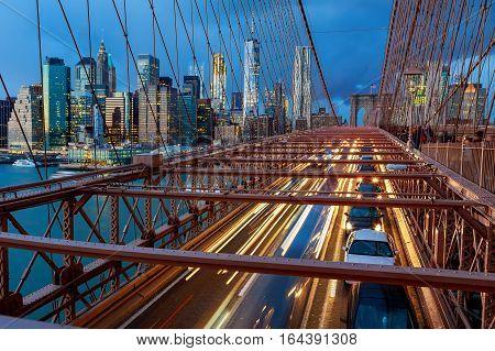 View of Brooklyn Bridge at night with car traffic night Brooklyn Bridge