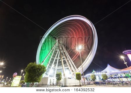 ABU DHABI UAE - NOV 26 2016: Marina Eye ferris wheel illuminated at night. City of Abu Dhabi United Arab Emirates