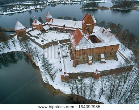 Trakai, Lithuania: aerial winter UAV top view, flat lay of gothic Island Castle. Historical residence in capital city of Grand Duchy of Lithuania, located in Galve lake