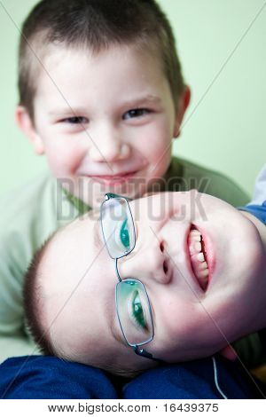 two little brothers happy together (shallow DOF; color toned image) poster