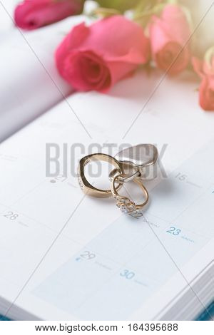 Wedding Gold Rings Locked With Lock On Calender