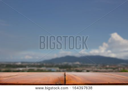 Empty top of wooden table or counter and mountain view of landscape background.For product display