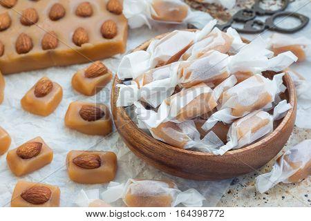Homemade soft caramel candy with almonds horizontal