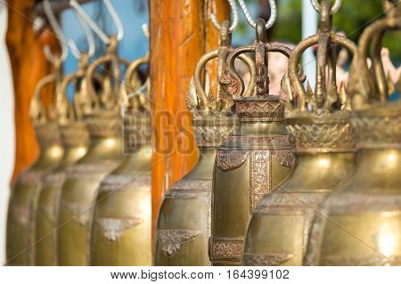 Close up golden bells in Buddhism temple, Thailand