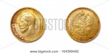 Ten rubles - old golden coin from Russia with a portrait of Nicholas II. The text on the obverse says
