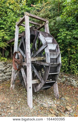 close up of restored wooden watermill wheel