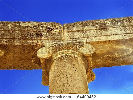 Ionic Coumn Oval Plaza Ancient Roman City Jerash Jordan. Jerash came to power 300 BC to 100 AD and was a city through 600 AD. Not conquered until 1112 AD by Crusaders. Famous Trading Center. Most original Roman City in the Middle East.