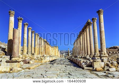 Corinthian Columns Ancient Roman Road City Jerash Jordan. Jerash came to power 300 BC to 100 AD and was a city through 600 AD. Not conquered until 1112 AD by Crusaders. Famous Trading Center. Most original Roman City in the Middle East.