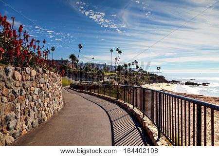 Heisler Park walkway overlooking the coastline cliffs of Laguna Beach, California in winter.