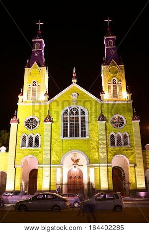 CASTRO CHILE - FEBRUARY 5 2016: The facade of the Church of San Francisco which was declared UNESCO World Heritage in 2000. The church is located at the Plaza de Armas main square in the center of Castro the capital of Chiloe Archipelago.