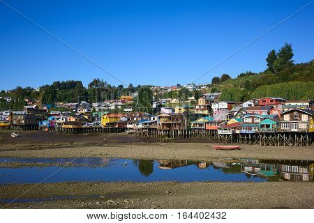 Colorful Palafitos traditional wooden stilt houses at low tide in Castro the capital of the Chiloe Archipelago in Chile