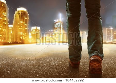 Man walking in the city at night