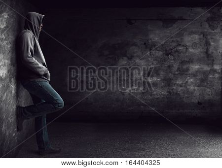 Lonely mysterious man standing alone at night