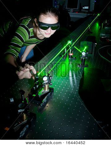 female scientist working with lasers while doing research in a quantum optics lab