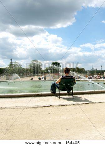 Man Reading In Paris