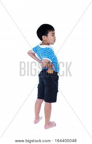 Asian Child Rubbing The Muscles Of His Lower Back. Isolated On White Background.