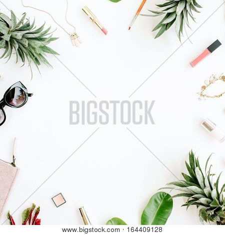 Frame of modern woman accessories collage. Sunglasses purse lipstick bracelet necklace and pineapples. Flat lay top view