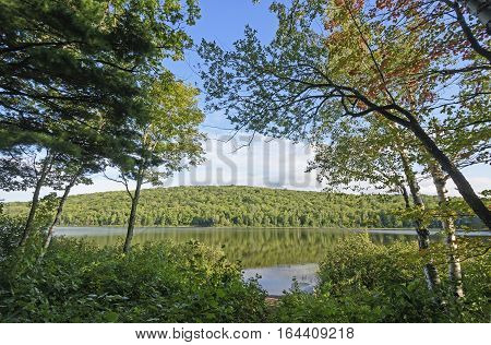 Looking at a Forested Lake of the Clouds in Porcupine Mountains National Park in Michigan