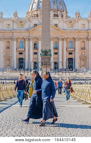 Nun Walk Through Saint Peter's Square By The Basilica In Vatican