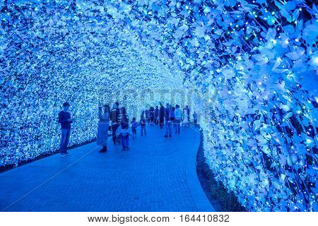 MieNagoya Japan - November 23 2015 : Unidentified tourist in blur motion visiting Nabana no sato winter illumination in Mie NagoyaJapan. It is one of Japan's largest illumination parks.