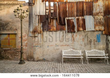 White chair with evening sun,Brick wall background