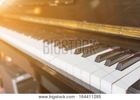 Piano with a light shining,Closeup And orange light