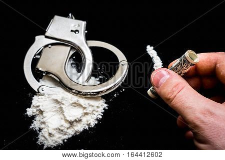 Hand Of Man Holds Rolled Banknote For Snorting Cocaine