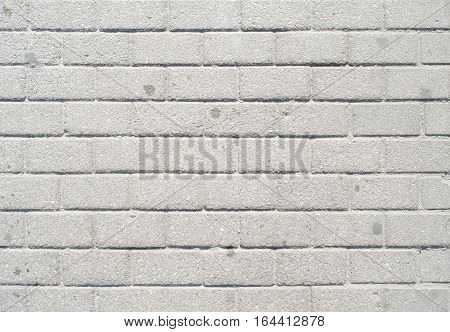 White brick wall paid close. Textural background
