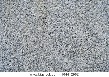 Gray concrete wall close paid. Background texture