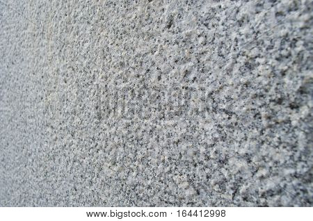 Gray concrete wall close paid. Blurred background