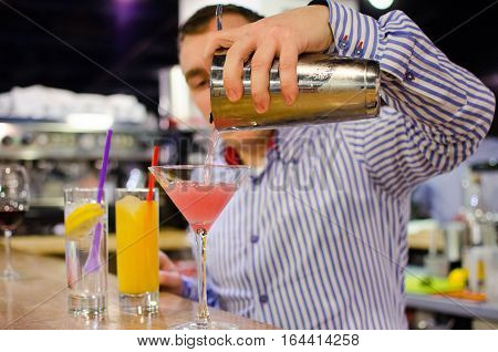 Bartender is making some soft drinks in the restaurant