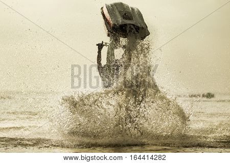 Jet Ski Freestyle A man driving jet ski free style