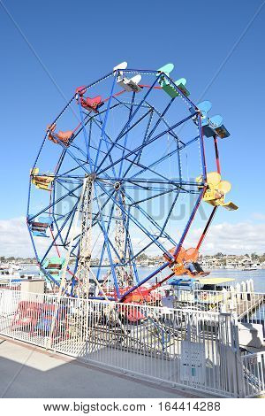 NEWPORT BEACH CALIFORNIA - JANUARY 6 2017: Fun Zone Ferris Wheel. Rebuilt in 1986 the Fun Zone arcade food shops boutiques and ferris wheel are an area highlight.