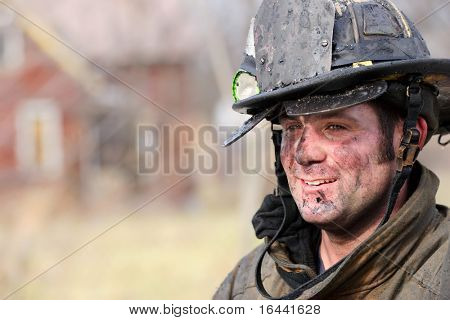 Firefighter rests after fighting a house fire