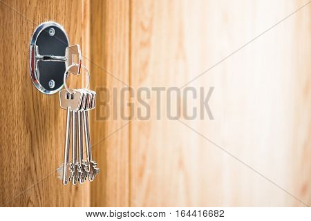 metal keys in the keyhole, abstract background